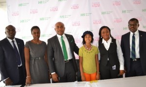 From left, CIBN Representative , Mr. Tade Fadare; CBN Representative,Mrs Bunmi Adebiyi;Group Head- Customer Experience and Analytics, Heritage Bank, Mr. Raphael  Omoregie; the  Heritage Bank Financial Literacy Brand Ambassador,Miss Zuriel Oduwole ,Executive Director- Ivory Banking, Heritage Bank , Mrs. Mary Akpobome and Executive Director, Manila Banking, Heritage Bank, Mr. Niyi Adeseun during the  Launch of Heritage Bank Financial Literacy program at the Heritage Bank Training School, Victoria Island,Lagos,on Wednesday, 26/2/2014.