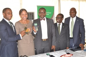 L-R; Group Head, eBank, Tobi Nnadozie, Group Head, Ivory Banking, Heritage Bank, Rabi Momoh, Executive Director, Manila Banking, Heritage Bank, Niyi Adeseun; Group Head, Business Services , Heritage Bank, Wunmi Adeniyi and  Group Head , Cowry Banking / Retail Bank Heritage Bank, Davison Regha, during the launch of the first Mpos (mobile pos) in Nigeria by Heritage Bank