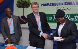 L-R) Andrew Enahoro, Head, Legal/Public Relations, Promasidor Nigeria Limited; Olivier Thiry, Managing Director, Promasidor; and Adetola Onisarotu, Director, Laboratory Services, Lagos State Environmental Protection Agency (LASEPA); at the 'Tree Planting Day' celebration held at Promasidor Hea dquarters in Isolo, Lagos