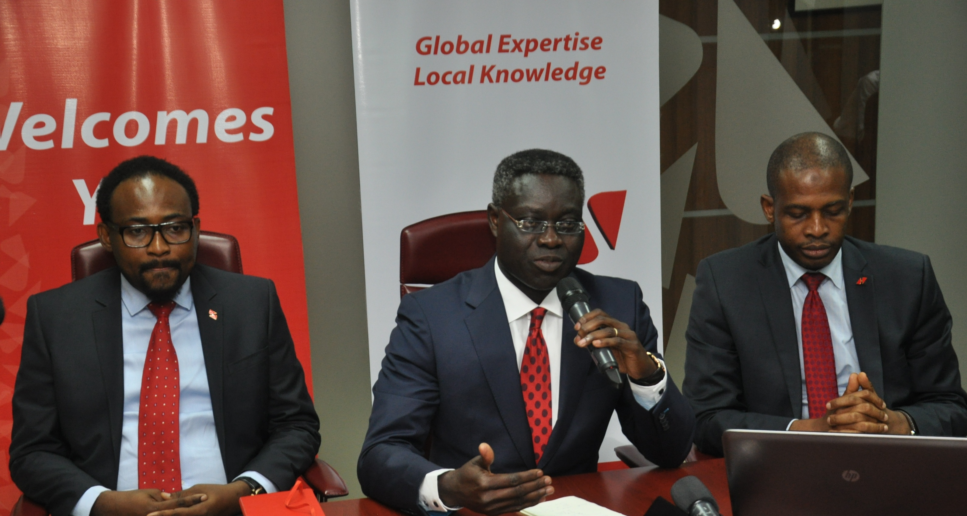 l-r: Group Managing Director/CEO, UBA Plc, Mr. Phillips Oduoza (Centre) flanked by Divisional Head, IT Project Management, Mr. Lanre Bamisebi and Director, Information Technology, UBA Plc, Mr Rasheed Adegoke during the press launch of the Bank's simplified solution for Biometric Verification Numbers (BVN) registration, in Lagos on Monday