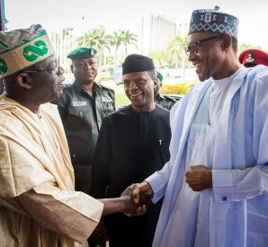 President Buhari being received by Chief Bola Ahmed Tinubu
